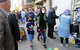 Iranians walk in the streets of the capital Tehran, May 9, 2020. (Atta Kenare/AFP)