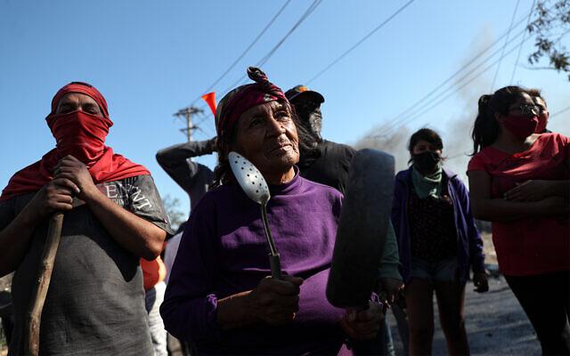 Demonstrators gather near a burning barricade during a protest demanding food aid in Santiago, Chile, May 26, 2020. (AP/Esteban Felix)