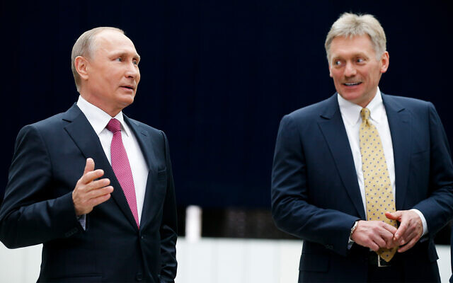 Russian President Vladimir Putin, left, and as his press secretary Dmitry Peskov, right, at a press event in Moscow, Russia, June 15, 2017. (AP/Alexander Zemlianichenko, File)