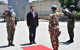 Lebanese Prime Minister Hassan Diab, center, stands next to the Head of Mission and Force Commander of the United Nations Interim Force in Lebanon, Major-General Stefano Del Col, left, as he reviews the honor guard of the United Nations peacekeepers in Naqoura, Lebanon, May 27, 2020. (Dalati Nohra via AP)