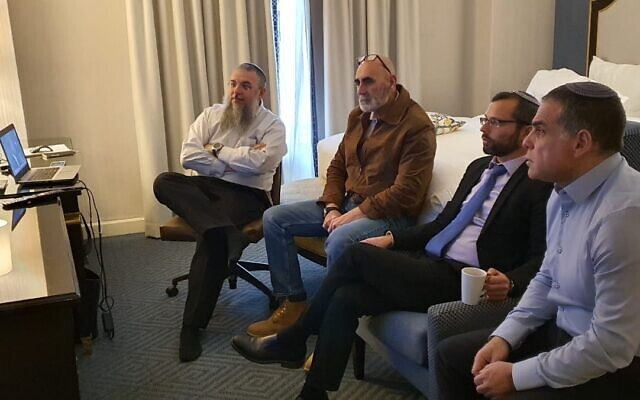 (From L-R) Gush Etzion Regional Council chairman Shlomo Ne'eman, Jordan Valley Regional Council chairman David Elhayani, Binyamin Regional Council chairman Yisrael Gantz and Efrat Local Council chairman Oded Revivi watch the unveiling of the Trump peace plan from a Washington hotel room on January 28, 2020. (Yesha Council)