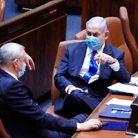 Blue and White chairman Benny Gantz (L) and Prime Minister Benjamin Netanyahu in the Knesset plenum on May 17, 2020. (Knesset)