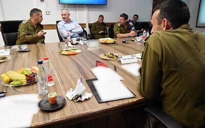 Defense Minister Benny Gantz, center, meets with IDF Chief of Staff Aviv Kohavi, left, and head of the Southern Command Herzi Halevi, right, in southern Israel on May 26, 2020. (Ariel Hermoni/Defense Ministry)