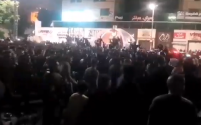 Palestinians gather to protest lockdown measures in Hebron, early Sunday, May 24, 2020 (video screenshot)