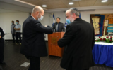 Outgoing Justice Minister Amir Ohana and Attorney General Avichai Mandelblit share an elbow bump during a ceremony at the Justice Ministry on May 18, 2020. (Shlomi Amsalem/GPO)