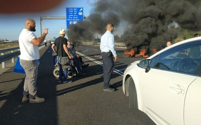 Activists block the Ayalon Highway near Tel Aviv on May 31, 2020, demanding increased stipends for people with disabilities. (Lavi Naor/courtesy)