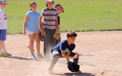 Kids play softball at Camp Ramah in California (Courtesy of Ramah in California)