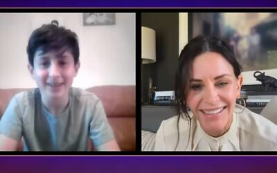 "Naftali Arden  (L) speaks with ""Friends"" star Courteney Cox after his ""Friends"" themed virtual Bar Mitzvah (screencapture/YouTube)"
