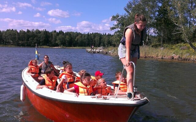 Boating is among the many activities at the 111-year-old Glamsta Jewish summer camp in Sweden. (Courtesy of Glämsta via JTA)