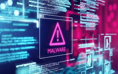 A computer screen with program code warning of a detected malware script program. (solarseven via iStock)