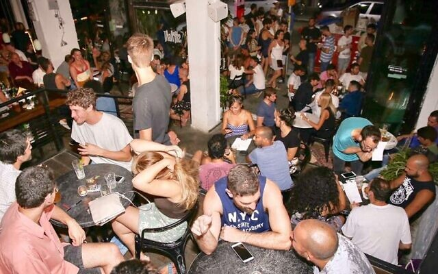 Tourists and locals partying at Tel Aviv's Shpagat bar in Tel Aviv, one of the oldest gay bars in the city (Courtesy)
