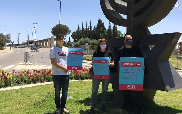 Moshe Nadler (right), pictured outside the Knesset in Jerusalem before submitting a 50,000 signature petition calling on lawmakers to cut their salaries in solidarity with the nation,  May 4, 2020. (Courtesy, Moshe Nadler)