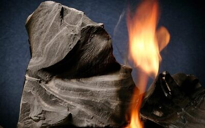 Oil shale rock burns on its own once lit with a blow torch. (AP Photo/Douglas C. Pizac)