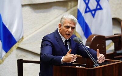 Opposition leader Yair Lapid at the Knesset as the 35th government of Israel is presented on May 17, 2020. (Knesset/Adina Veldman)