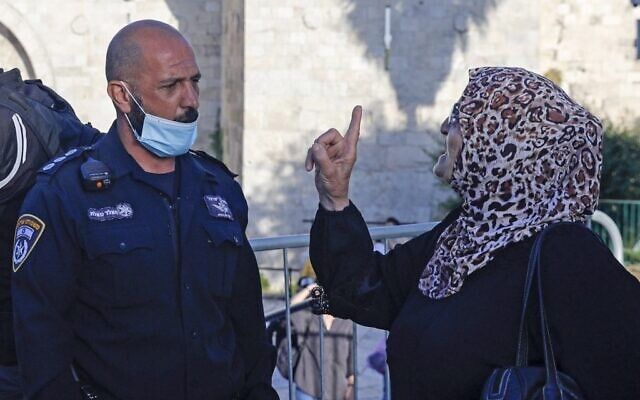 A Palestinian woman argues with a member of Israeli security forces, as she takes part in a protest at the Damascus Gate of the Old City of Jerusalem, on May 31, 2020, to condemn the shooting a day earlier of Iyad Hallak, a disabled Palestinian man who was shot dead by Israeli police who said they mistakenly thought he was carrying a gun. (AHMAD GHARABLI / AFP)