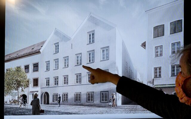 A man points his finger at a screen showing the planned architectural redesign of the house Adolf Hitler was born in, during a press conference at the interior ministry in Vienna, June 2, 2020. (Joe Klamar/AFP)