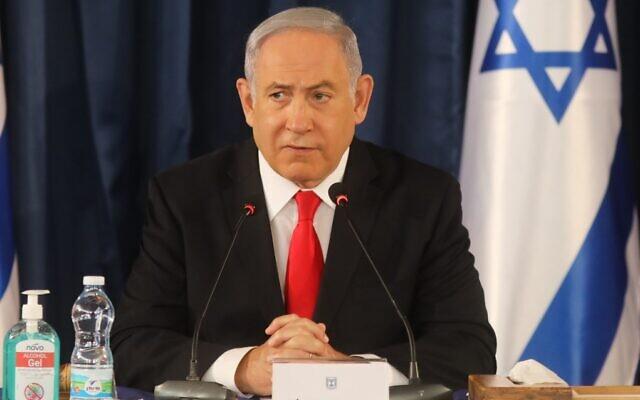 Prime Minister Benjamin Netanyahu chairs the weekly cabinet meeting in Jerusalem on June 7, 2020. (Menahem Kahana/AFP)