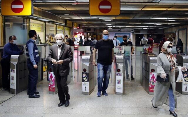 Iranians wearing face masks arrive at a metro station in the capital Tehran on June 10, 2020 amid the coronavirus Covid-19 pandemic crisis (STRINGER / AFP)