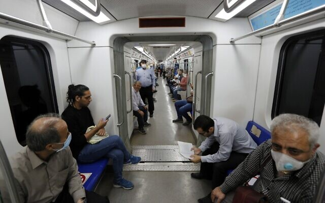 Iranians, mostly wearing face masks, are pictured in a train carriage at a metro station in the capital Tehran on June 10, 2020 amid the coronavirus pandemic crisis (STRINGER / AFP)