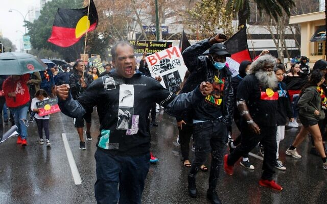 Demonstrators march through the streets during a Black Lives Matter protest to express solidarity with US protesters and demand an end to Aboriginal deaths in custody in Perth, Australia on June 13, 2020 (Trevor Collens / AFP)