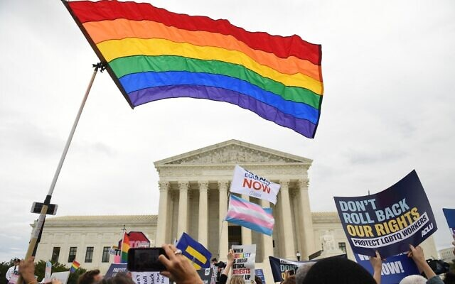 Illustrative: Demonstrators in favor of LGBT rights rally outside the US Supreme Court in Washington, October 8, 2019. (Saul Loeb/AFP)