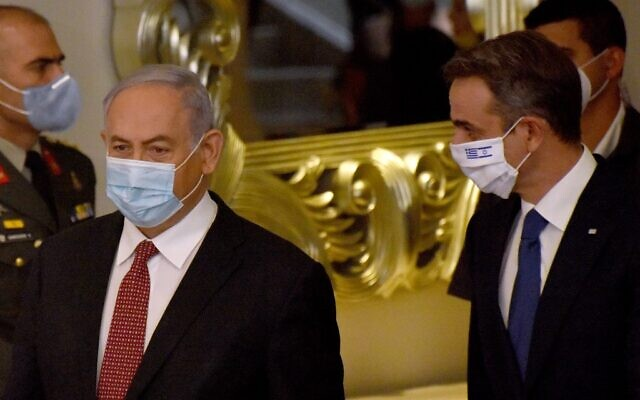 Israeli Prime Minister Benjamin Netanyahu (L) and his Greek counterpart Kyriakos Mitsotakis, both wearing face masks against the coronavirus Covid-19, arrive to deliver joint statements in Jerusalem on June 16, 2020. (DEBBIE HILL / POOL / AFP)