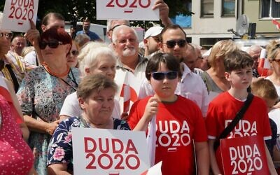Supporters attend a campaign meeting of Polish President and candidate to his reelection for his Law and Justice (PiS) party Andrzej Duda in Plonsk, central Poland on June 16, 2020. (JANEK SKARZYNSKI/AFP)