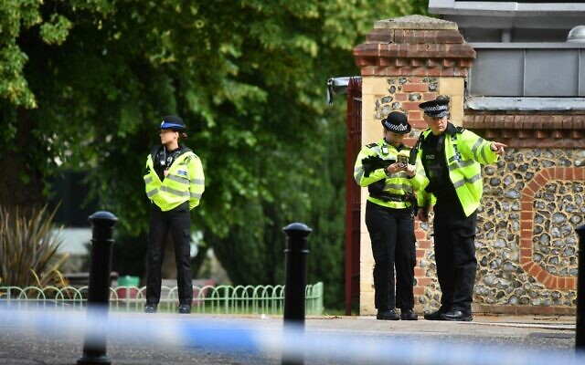 Police officers secure a police cordon near Forbury Gardens park in Reading, west of London, on June 20, 2020 following a stabbing incident the previous day. (Photo by Ben STANSALL / AFP)