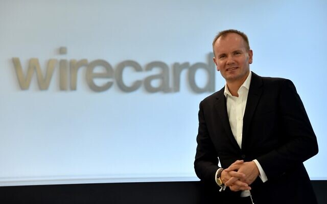 """In this file photo taken on September 18, 2018 Markus Braun, CEO of the technology and financial services company Wirecard, poses at the company's headquarters in Aschheim near Munich, southern Germany. Braun has been arrested on suspicion of market manipulation, German prosecutors said June 23, 2020,, after the payments provider admitted that 1.9 billion euros missing from its accounts likely """"do not exist"""". (Christof STACHE / AFP)"""