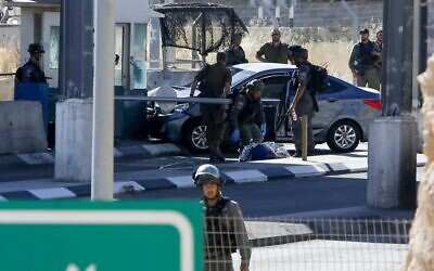 The scene of an alleged car-ramming attempt at a West Bank checkpoint near Abu Dis, east of Jerusalem, June 23, 2020. (Musa Al Shaer/AFP)