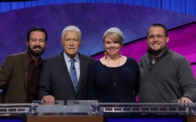 Meggie Kwait, a Jewish day school teacher from New York City, won $50,000 on the recent 'Jeopardy!' educators tournament. She is seen with host Alex Trebek, second from left, and the other two finalists. (Courtesy of Jeopardy Productions Inc./ via JTA)