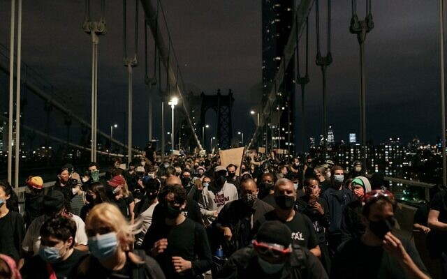 Protesters denouncing police brutality and systemic racism exit the Manhattan Bridge, June ,2 2020, after being stopped by police for hours during a citywide curfew in New York City. (Scott Heins/Getty Images/AFP)
