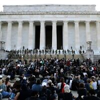 Members of the D.C. National Guard stand on the steps of the Lincoln Memorial monitoring a large crowd of demonstrators participating in a peaceful protest against police brutality and the death of George Floyd, on June 2, 2020 in Washington, DC. (Win McNamee/Getty Images/AFP)