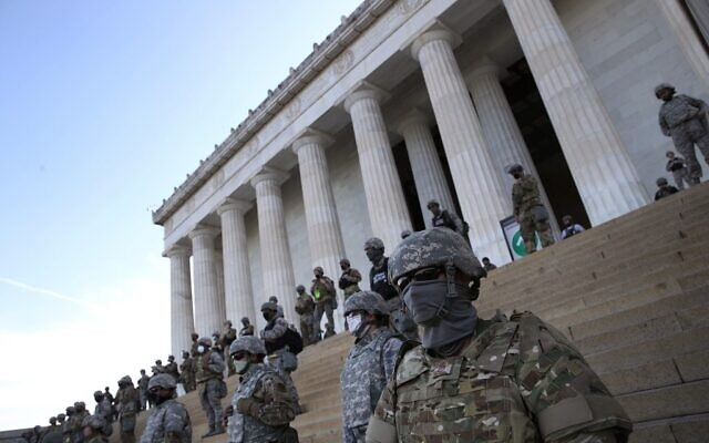 Members of the DC.National Guard stand on the steps of the Lincoln Memorial as demonstrators participate in a peaceful protest against police brutality and the death of George Floyd, on June 2, 2020 in Washington, DC. Protests continue to be held in cities throughout the country over the death of George Floyd, a black man who was killed in police custody in Minneapolis on May 25.   (Win McNamee/Getty Images/AFP)
