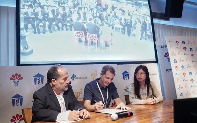 Rani Shifron, CEO of Healthier Globe, left to right, Tsvi Shmilovich, CEO EZMEMS, Muna Lo, Secretary of the Economic Division of the Taiwan Embassy in Israel (Nati Levi)