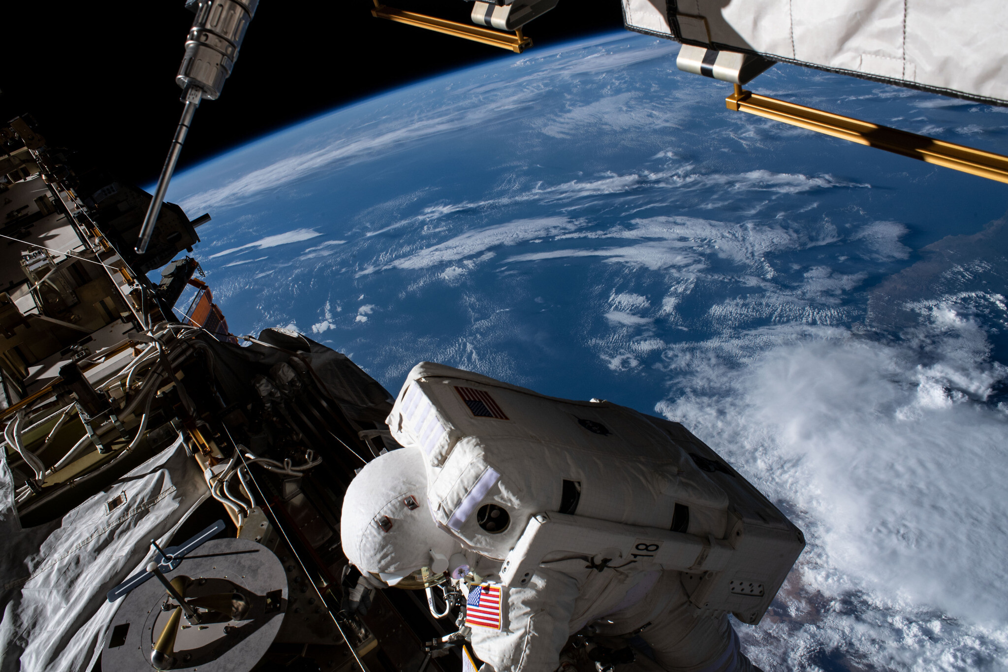 Illustrative: NASA astronaut Jessica Meir on a space walk outside the ISS, with the earth in the background. (NASA)