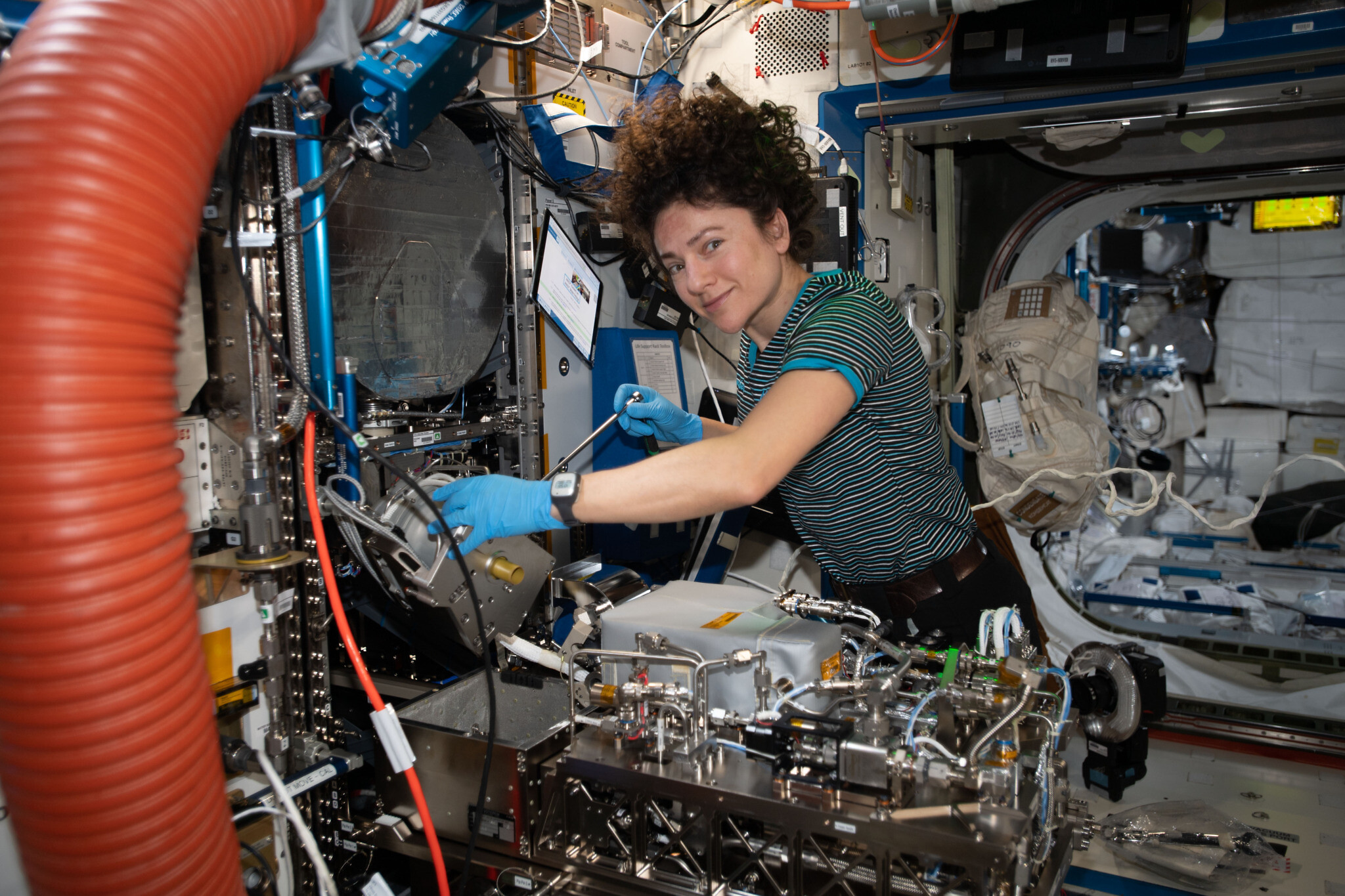 NASA astronaut Jessica Meir working with technical hardware on the ISS. (NASA)