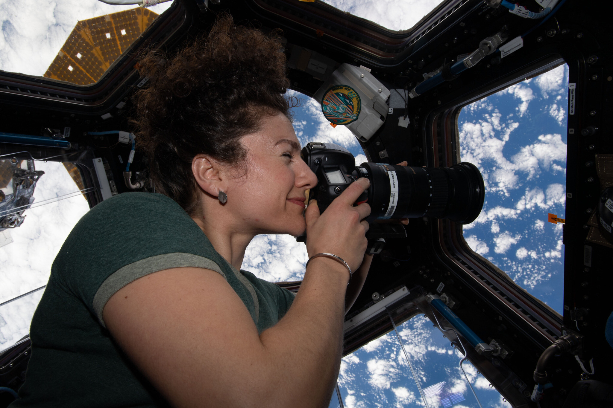 NASA astronaut Jessica Meir take photos of earth from a window of the ISS. (NASA)