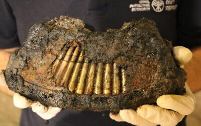 Magazine of a Bren machine gun found during an excavation under the Western Wall tunnels (Yoli Schwartz, Israel Antiquities Authority)