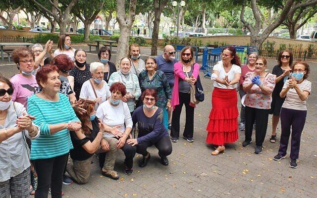 Participants in the Golden Gardens program clap for a speaker. (Yalya Galam/Iris Cohen/ via JTA)