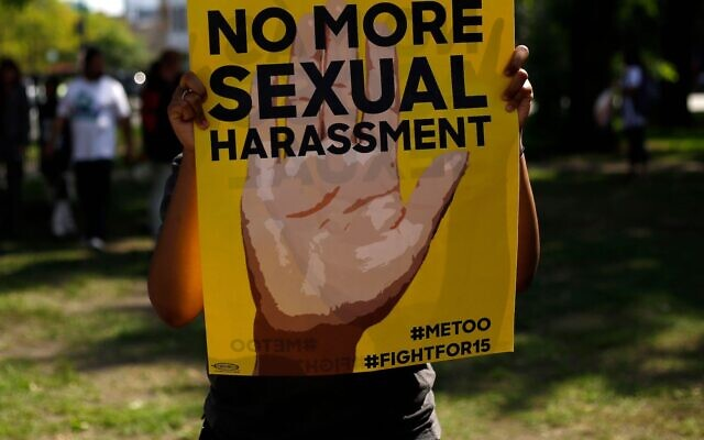 Illustrative: A sign at a protest in Chicago against sexual harassment in the workplace, September 18, 2018. (Joshua Lott/AFP via Getty Images via JTA)