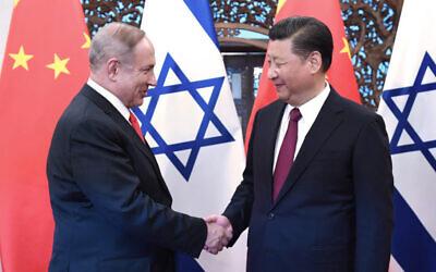Israeli Prime Minister Benjamin Netanyahu meets with Chinese President Xi Jinping in Beijing, March 21, 2017. (Xinhua/Rao Ainmin/ via JTA)