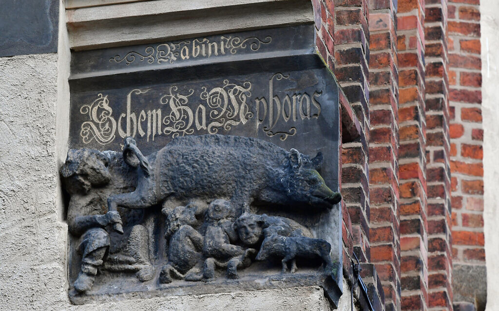 A Judensau sculpture on display on the outer wall of the town church of St. Marien in Wittenberg, Germany, February 4, 2020. (Hendrik Schmidt/picture alliance via Getty Images/ via JTA)