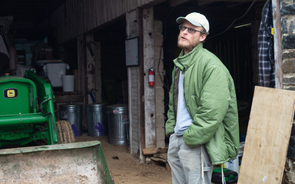 Ian Yosef Hertzmark at his farm in Randallstown, Maryland, in February. His sales of flour have more than doubled during the pandemic. (Mike Tintner/ via JTA)
