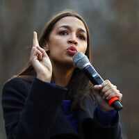 Democratic US Representative Alexandria Ocasio-Cortez of New York speaks at a campaign rally for then-Democratic presidential candidate Bernie Sanders, at the University of Michigan in Ann Arbor, Michigan, March 8, 2020. (AP Photo/Paul Sancya, File)