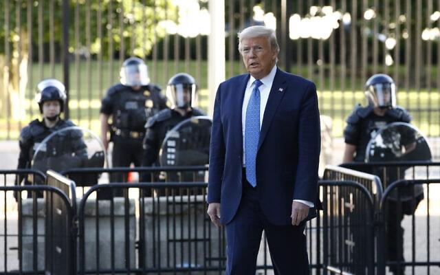 US President Donald Trump walks in Lafayette Park to visit outside St. John's Church across from the White House,  in Washington, June 1, 2020. (Patrick Semansky/AP)