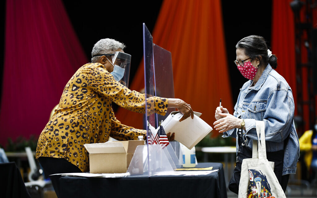 Illustrative: A voter, right, checks in with an election worker before casting her ballot in the Pennsylvania primary in Philadelphia, June 2, 2020. (AP Photo/Matt Rourke)