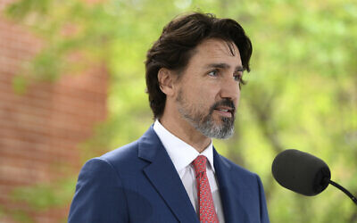 "In this May 19, 2020, file photo, Canadian Prime Minister Justin Trudeau speaks during his daily news conference on the COVID-19 pandemic outside his residence at Rideau Cottage in Ottawa, Ontario. Trudeau said Tuesday, June 2, that Canadians are watching what's unfolding in the United States with ""horror and consternation"" and he paused for 21 seconds when asked about US (Justin Tang/The Canadian Press via AP, File)"