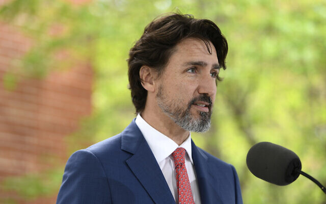 In this May 19, 2020, file photo, Canadian Prime Minister Justin Trudeau speaks during his daily news conference on the COVID-19 pandemic outside his residence at Rideau Cottage in Ottawa, Ontario. (Justin Tang/The Canadian Press via AP, File)