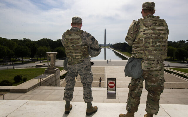 Members of the District of Columbia Army National Guard stand guard at the Lincoln Memorial in Washington, Wednesday, June 3, 2020, securing the area as protests continue following the death of George Floyd, a who died after being restrained by Minneapolis police officers. (AP Photo/Manuel Balce Ceneta)